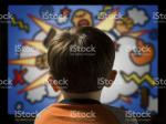 child-from-behind-watching-violent-cartoon-on-television-picture-id92671576